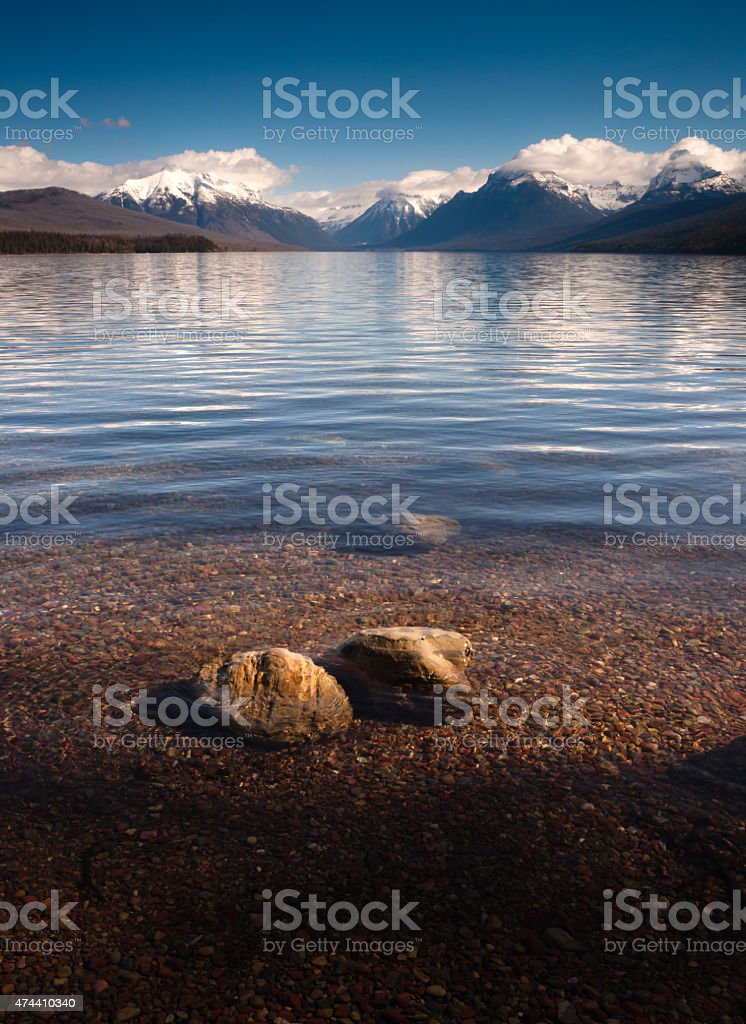 Clear Water Polished Rocks Lake McDonald Glacier National Park stock photo