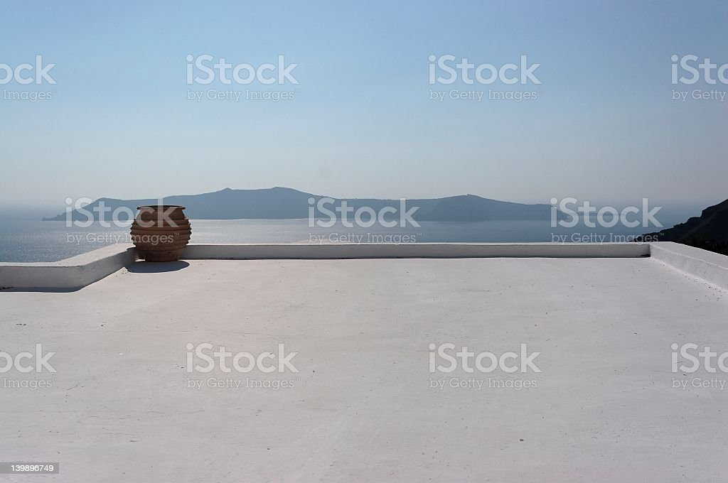 A clear white roof top overlooking the water royalty-free stock photo