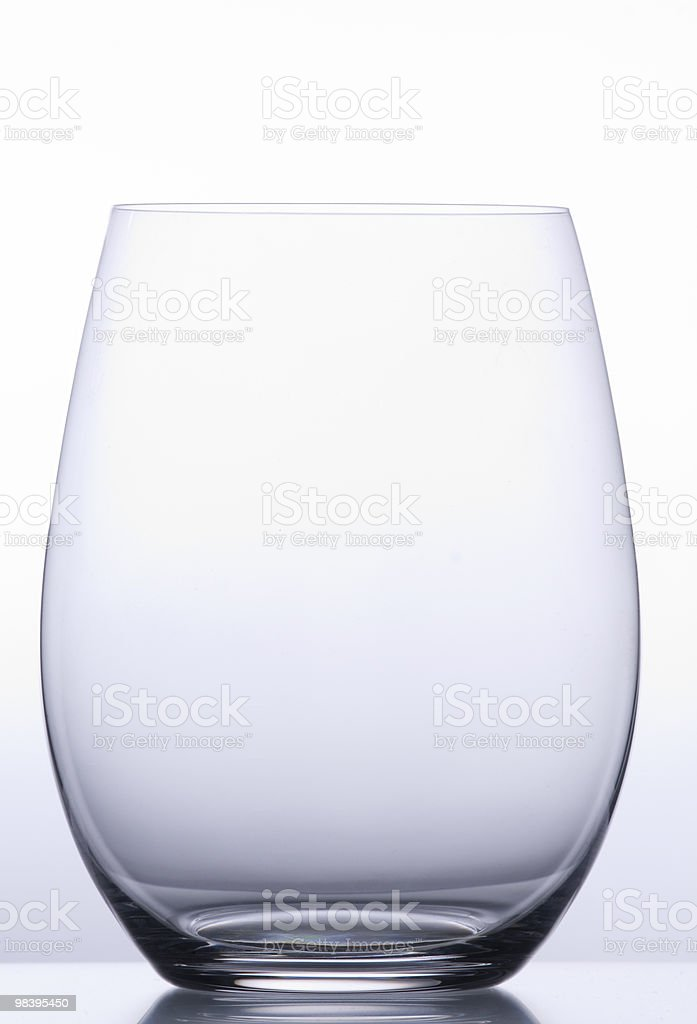A clear wine glass on a white background royalty-free stock photo