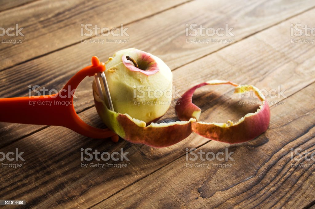 cleared apple on a wooden background stock photo