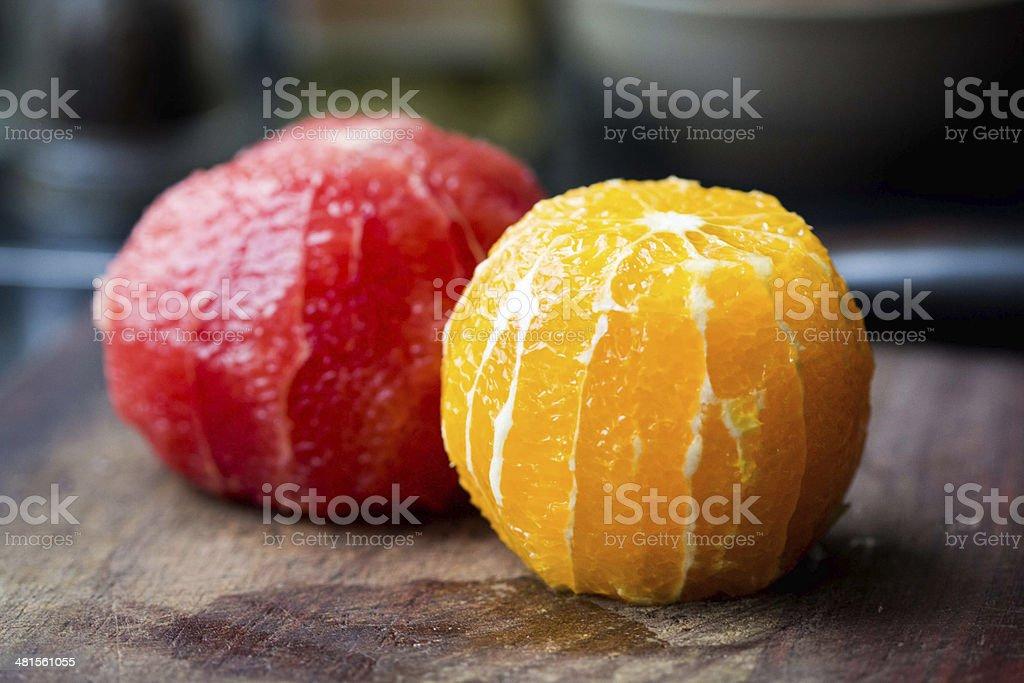 Cleared of peel orange and grapefruit stock photo