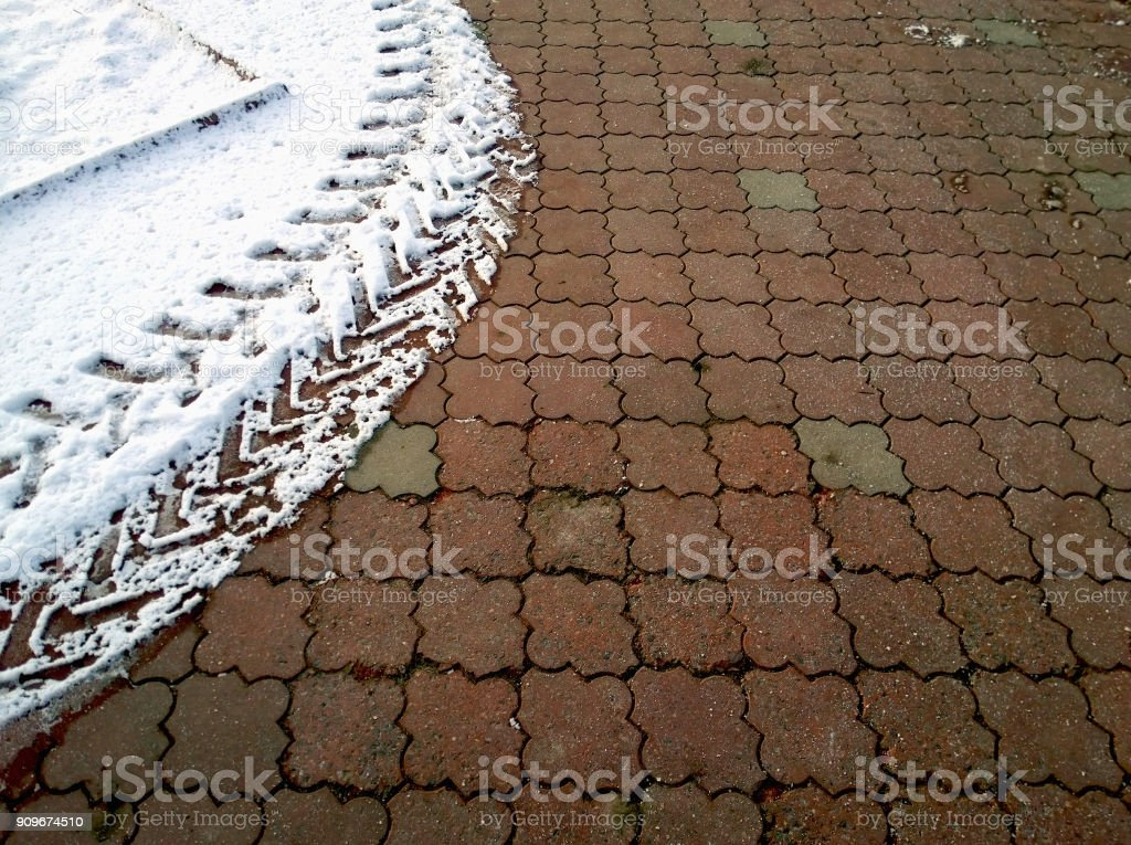 Cleared snow on sidewalk. Selective focus. stock photo