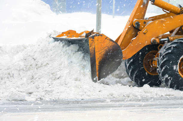 Clearing snow drifts stock photo