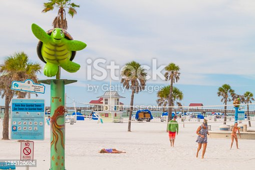 September 20, 2020 - Clearwater Beach, St. Petersburg, Florida, United States of America USA: A general landscape of Clearwater Beach, one of the most famous beaches around United States. A tourist family group playing volleyball and enjoying a summer day beach during Covid-19 Corona Virus Pandemic illness breakdown.  Clearwater Beach is one hour driving from Tampa and four hours driving from Miami.