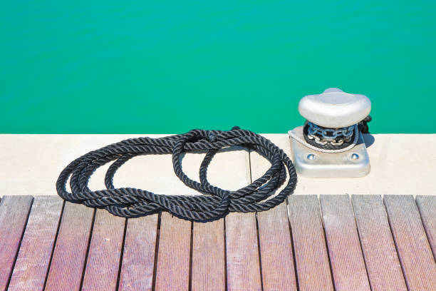 Cleat for mooring boats on wooden platform Cleat for mooring boats on wooden platform amortize stock pictures, royalty-free photos & images