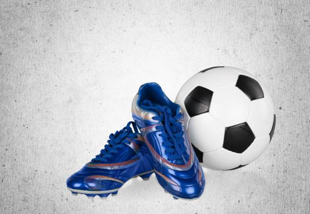 Cleats. Football boots. Soccer boots. Isolated on background studded stock pictures, royalty-free photos & images