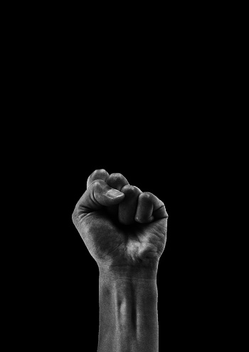 Clenched fist isolated on black background