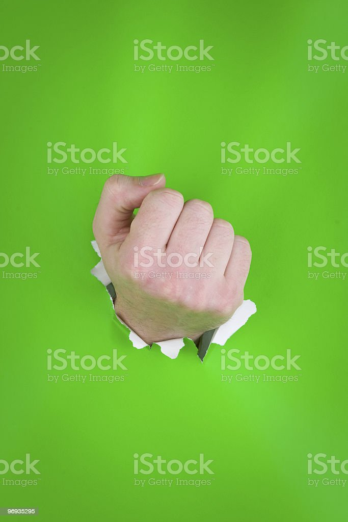 Clenched fist on green royalty-free stock photo