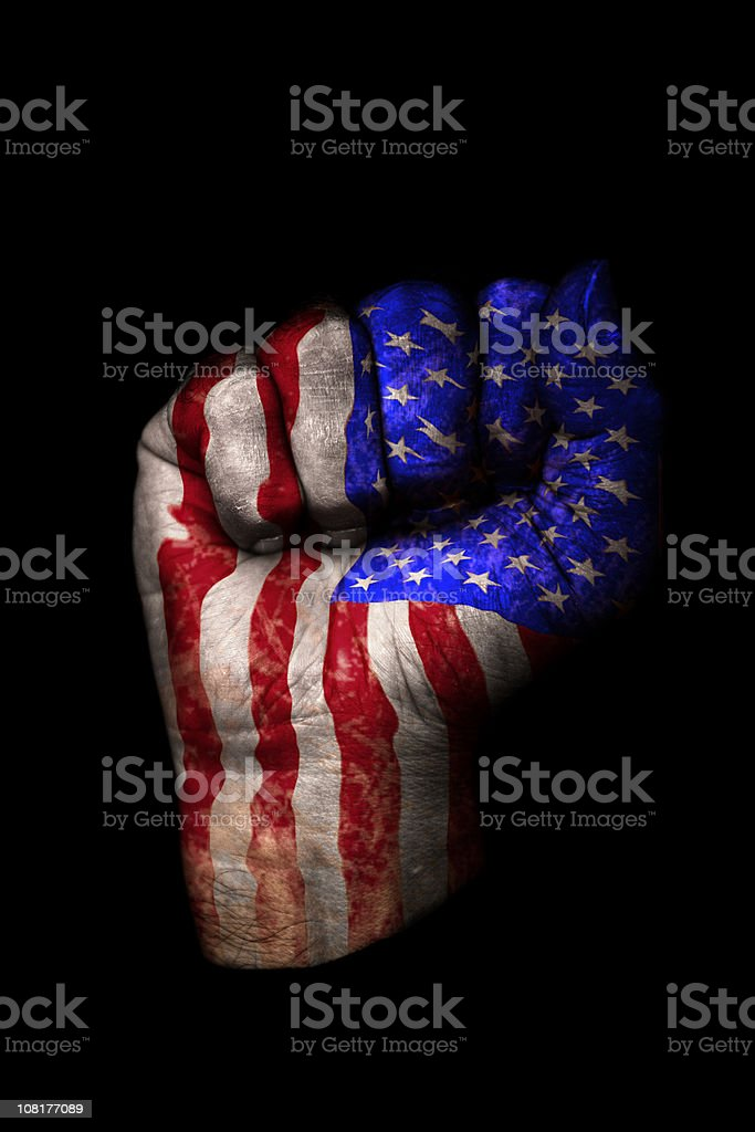 Clenched Fist with American Flag Painted, Isolated on Black royalty-free stock photo