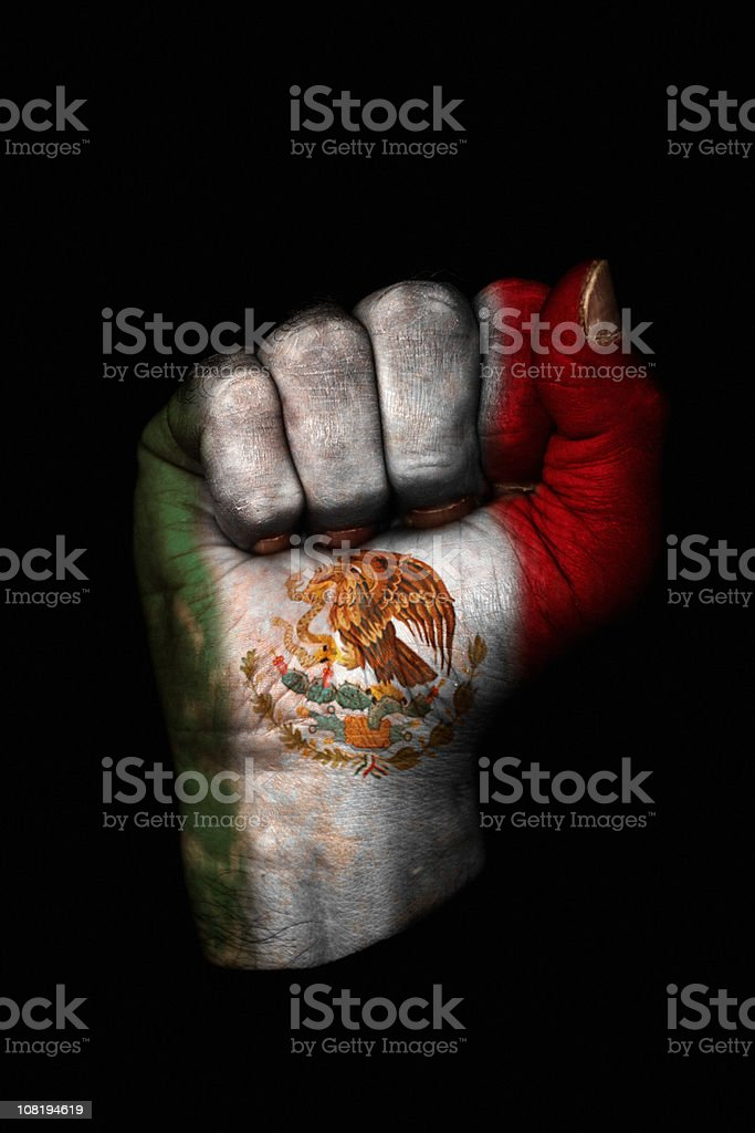 Clenched Fist with Mexican Flag Painted, Isolated on Black stock photo