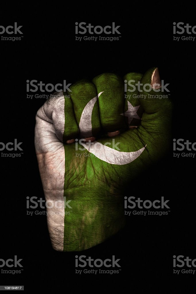 Clenched Fist with Pakistan Flag Painted, Isolated on Black stock photo