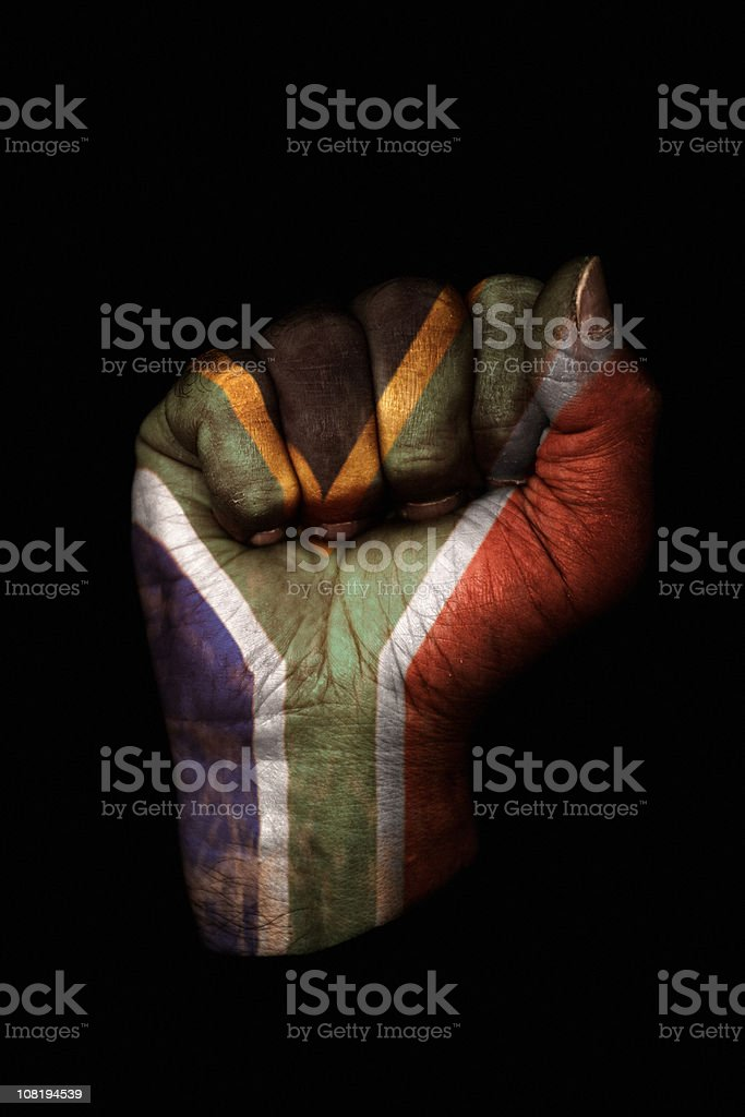 Clenched Fist with South African Flag Painted, Isolated on Black royalty-free stock photo