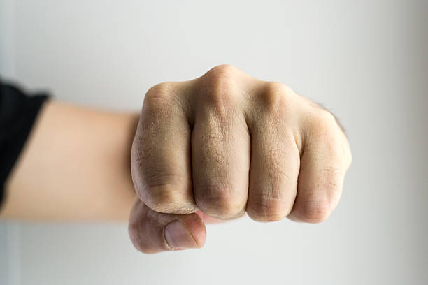 clenched white male fist boxing - punching stock photos and pictures