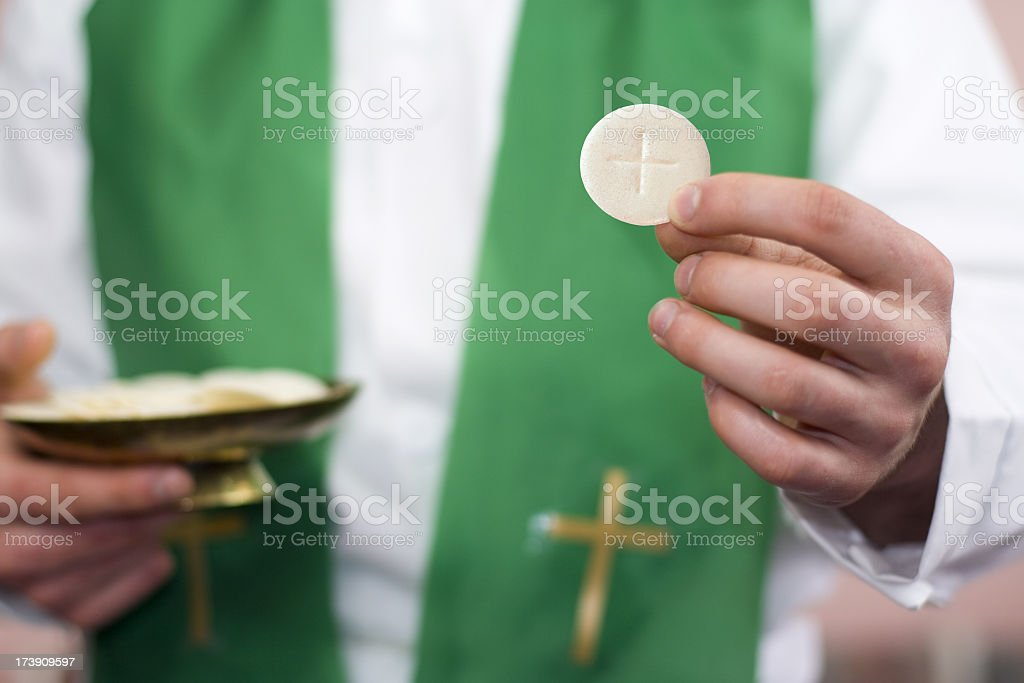 Clergyman and communion stock photo