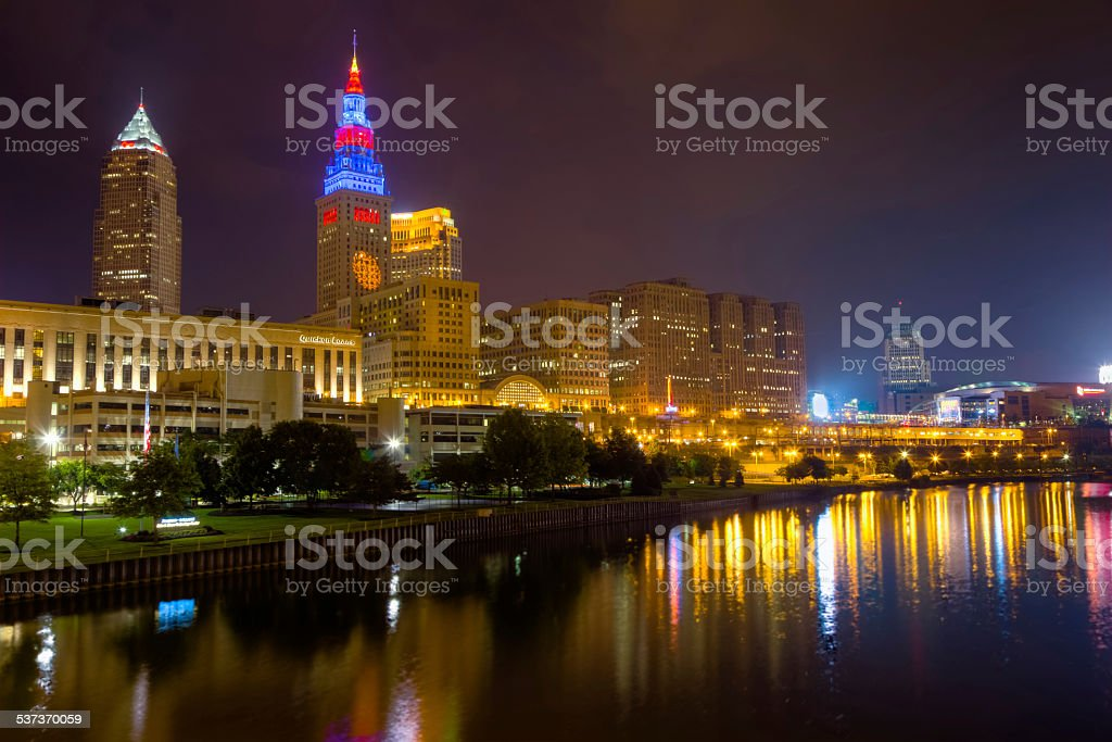 Cleveland Aglow at Night Reflecting on the Cuyahoga River stock photo