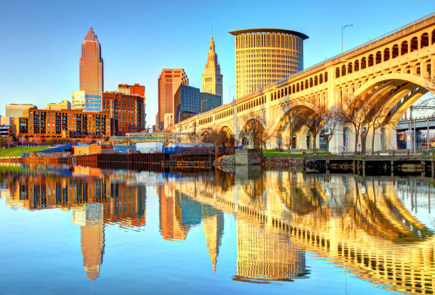 Cleveland Skyline reflecting on the Cuyahoga River Cleveland is a city in the U.S. state of Ohio and is the county seat of Cuyahoga County, the most populous county in the state ohio stock pictures, royalty-free photos & images