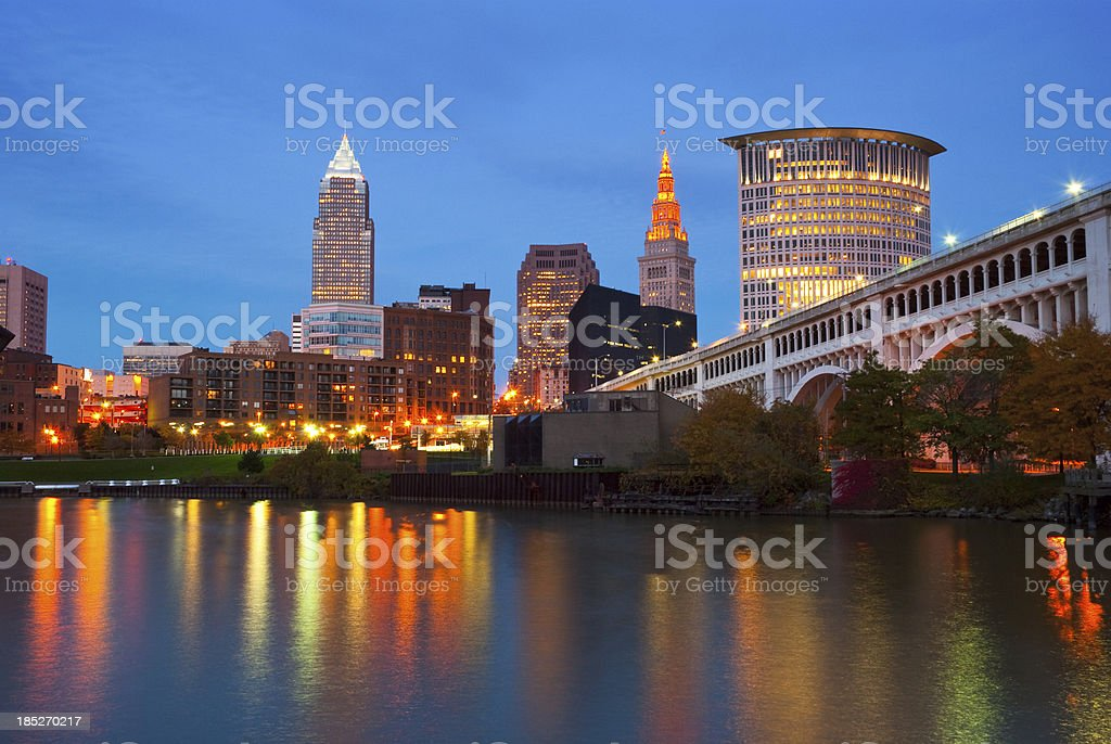 Cleveland skyline, river, and bridge at dusk stock photo