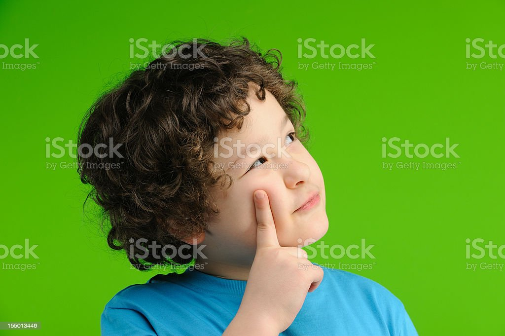 Clever boy thinking royalty-free stock photo