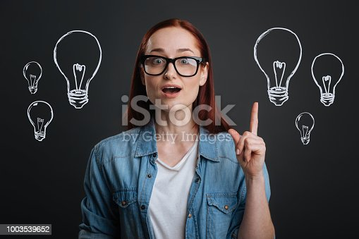 1003539592istockphoto Clever designer pointing her finger up while getting a brilliant idea 1003539652