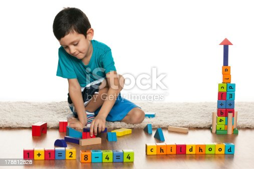 istock Clever little boy with toys on the floor 178812828