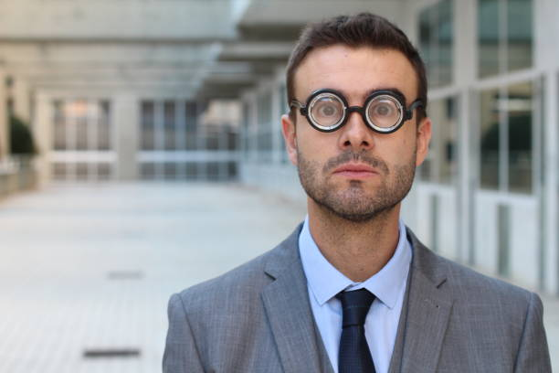 Clever male with very thick eyeglasses stock photo