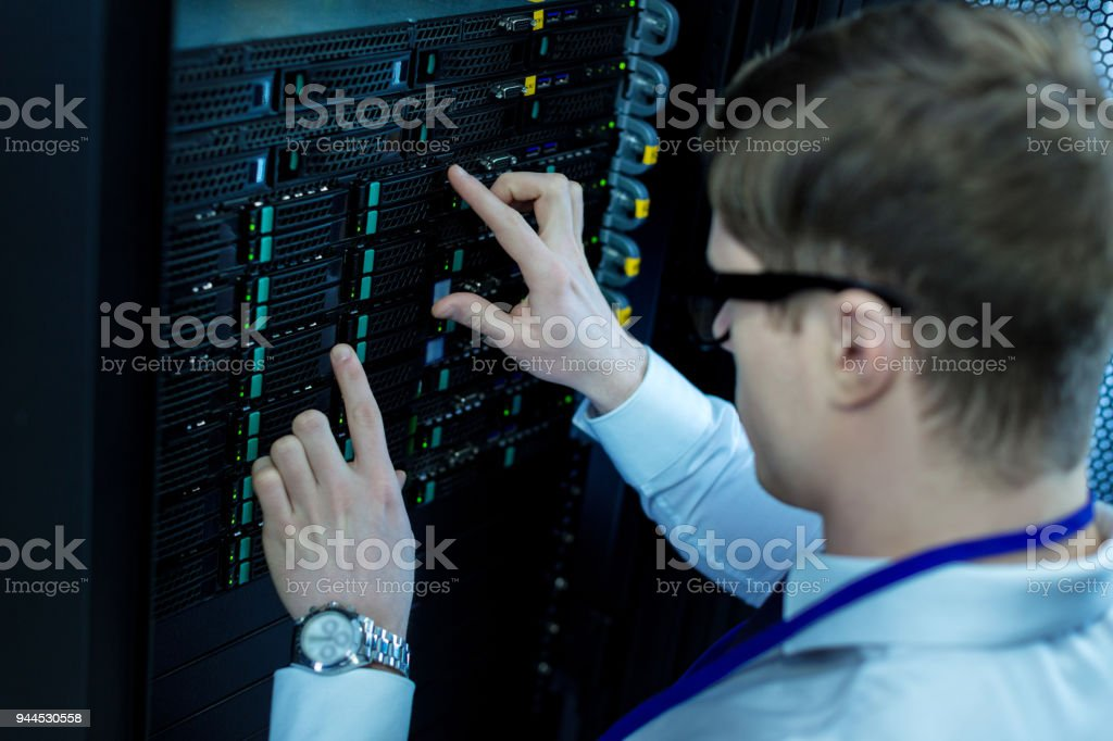 Clever operator pressing right buttons stock photo