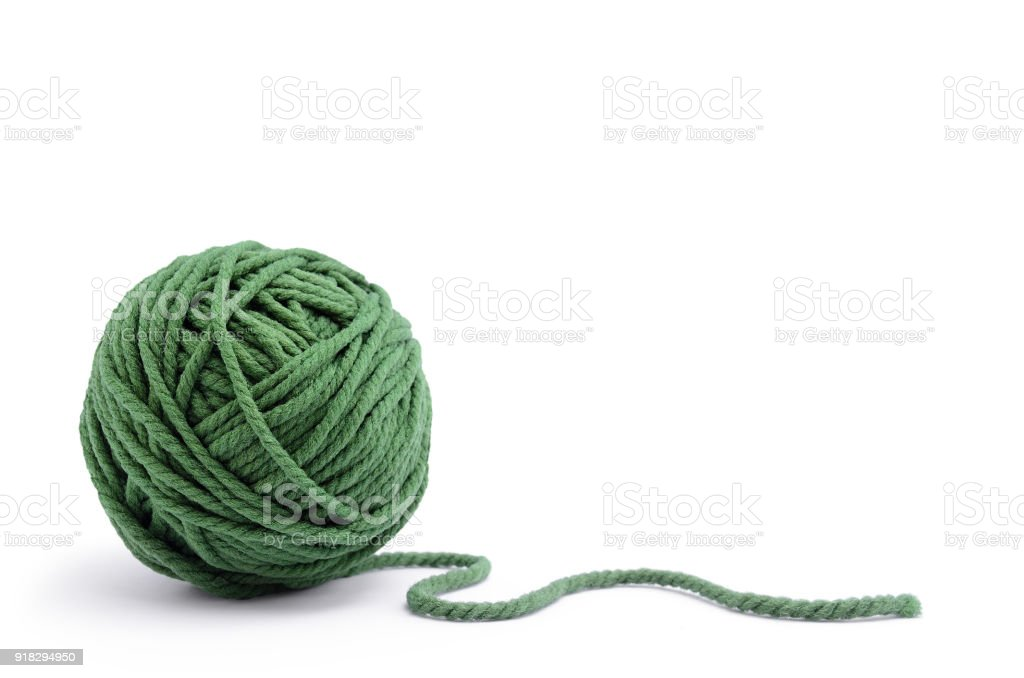 Clew of green thread for knitting isolated on white background stock photo