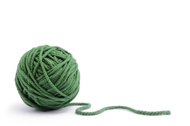 clew of green thread for knitting isolated on white background - wool stock photos and pictures