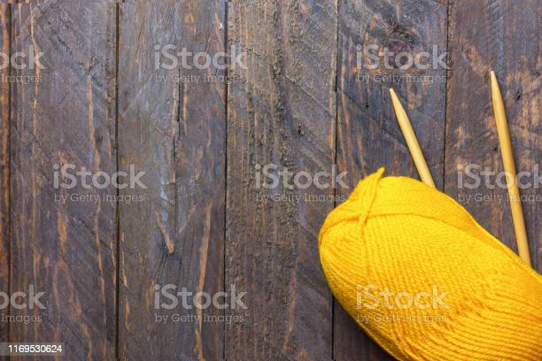 Clew of yellow wool yarn knitting needles on aged plank wood crafts picture id1169530624?b=1&k=6&m=1169530624&s=612x612&h=lhbjbtjlld1p y9to9l blajd3 o3lk x8vprbveq4c=