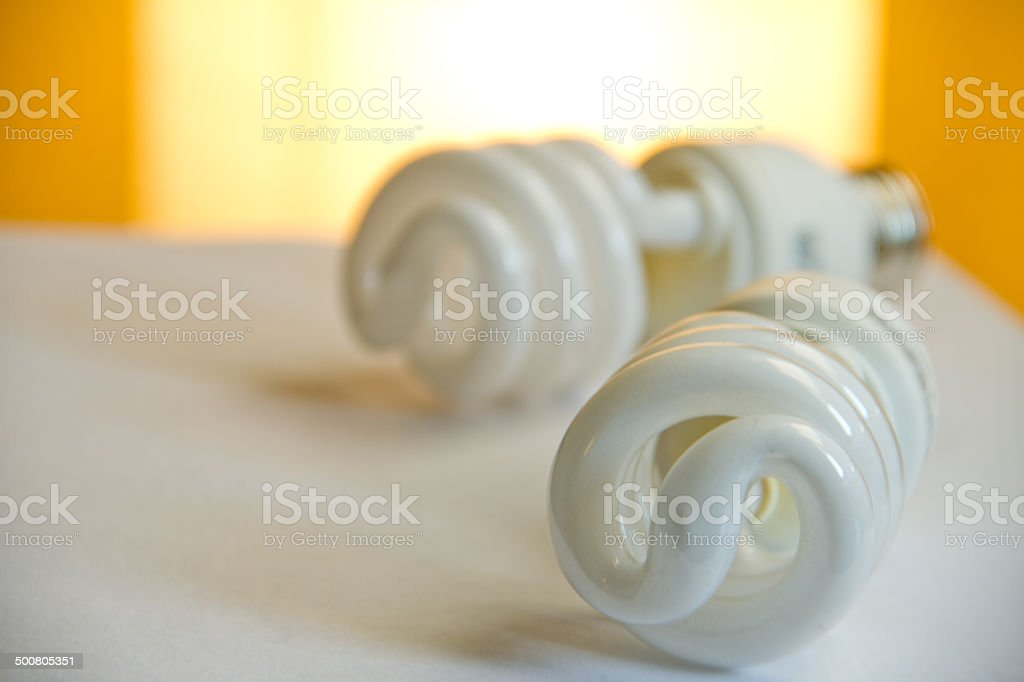 CLFs and efficiency and Compact Fluorescent Lightbulb stock photo