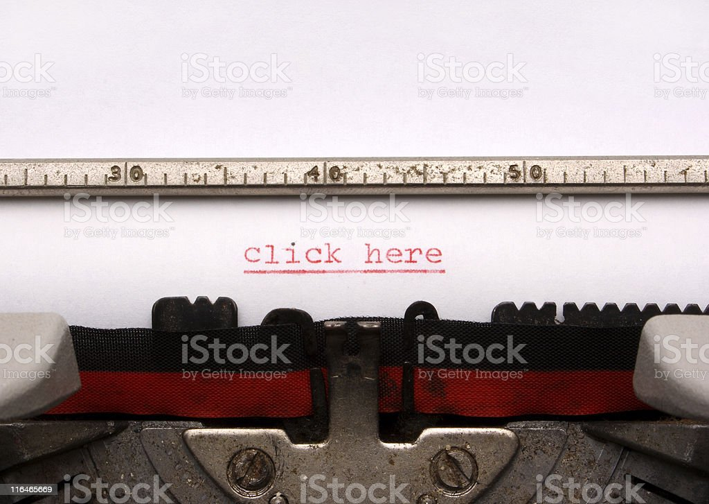 'Click here', written on a typewriter machine royalty-free stock photo
