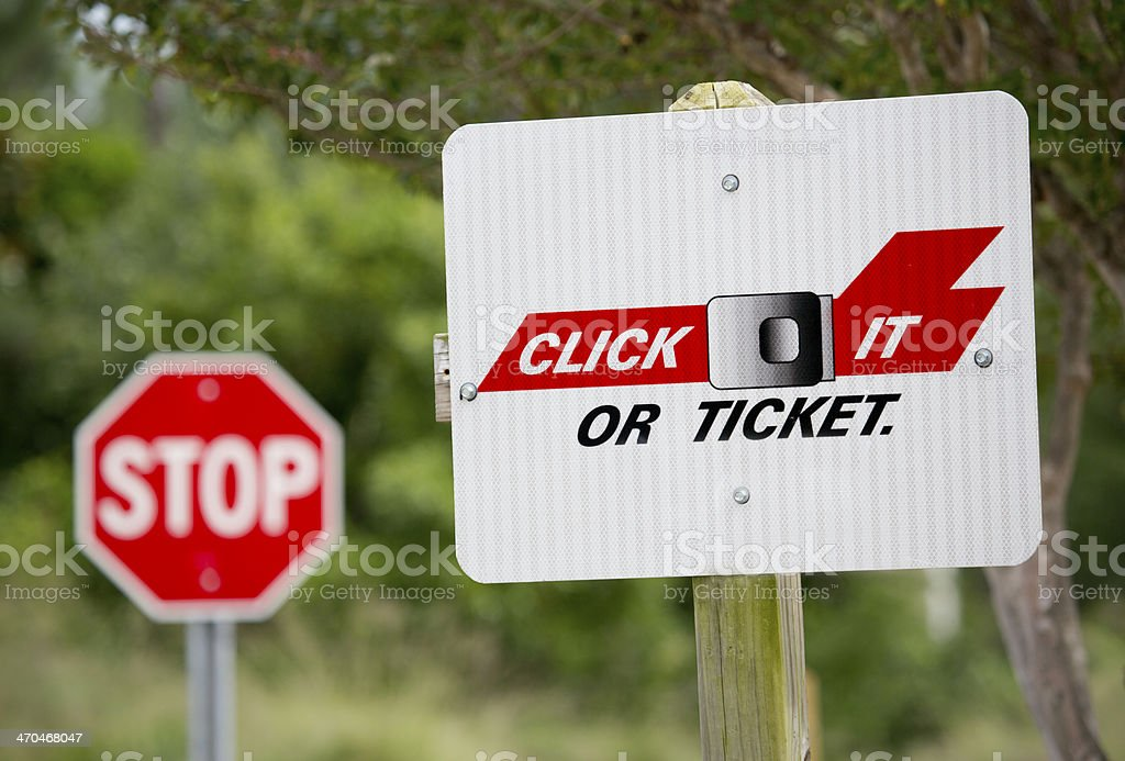 'Click it or Ticket' Warning with Stop Sign in Background stock photo