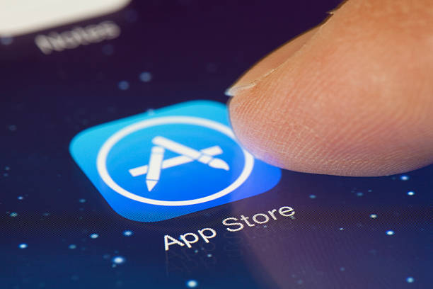 clicking the app store icon in ios 7 - app store stock photos and pictures