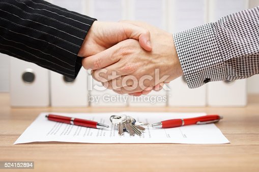 istock client and agent are handshaking over real estate contract 524152894