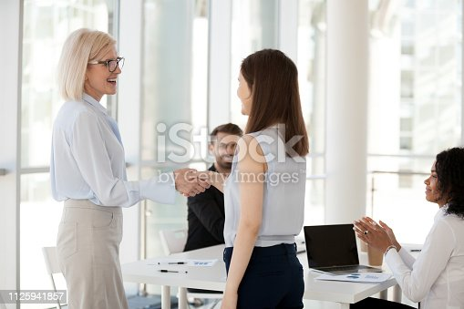 924520144 istock photo Client and executive shaking hands in business meeting 1125941857