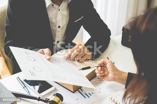 istock Client and lawyer have a sit down face to face meeting to discuss the legal options available 845393200