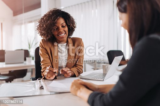 Female client consulting with a agent in the office
