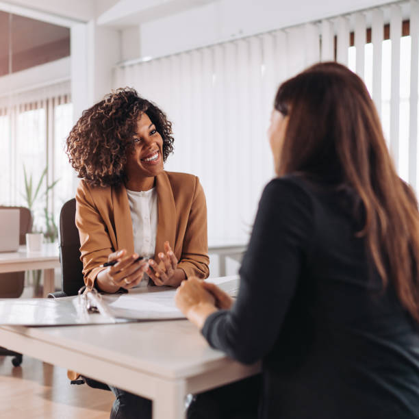 Client consulting with a agent Female client consulting with a agent in the office banking stock pictures, royalty-free photos & images