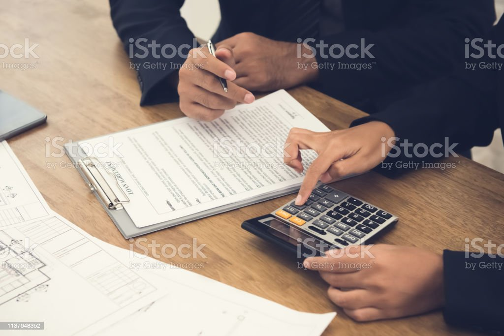 Client consulting with real estate agent stock photo