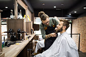istock Client during beard shaving in barber shop 1308801083