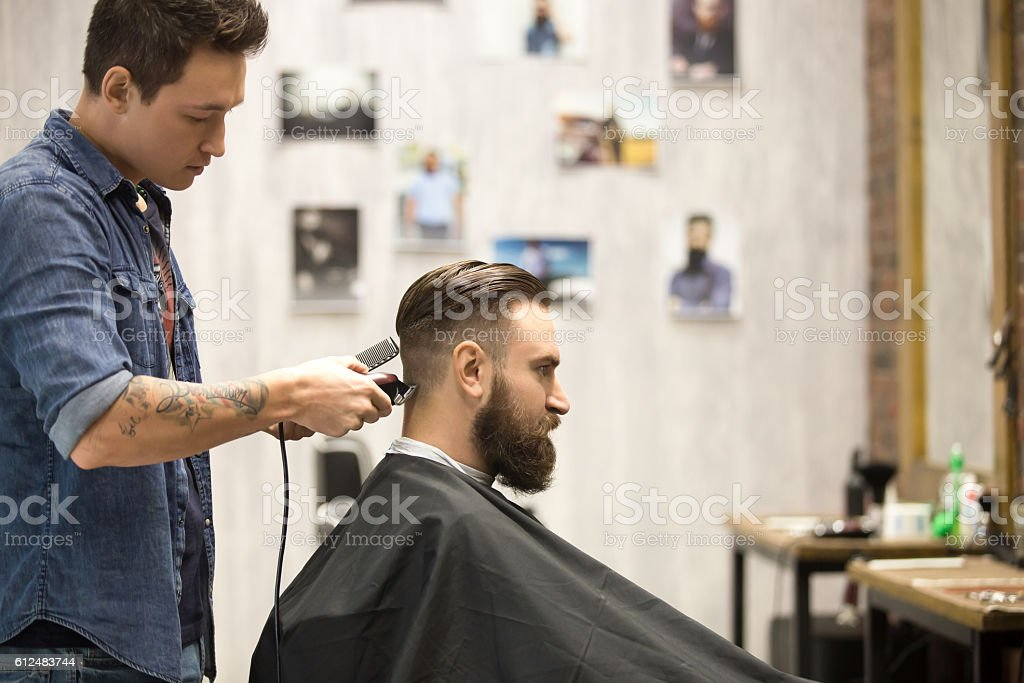 Client in barbershop stock photo