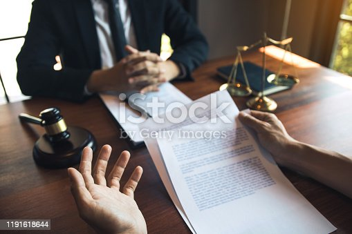 182148217istockphoto Client is explaining the offense to the lawyer and working together to solve the problem of the offense. 1191618644
