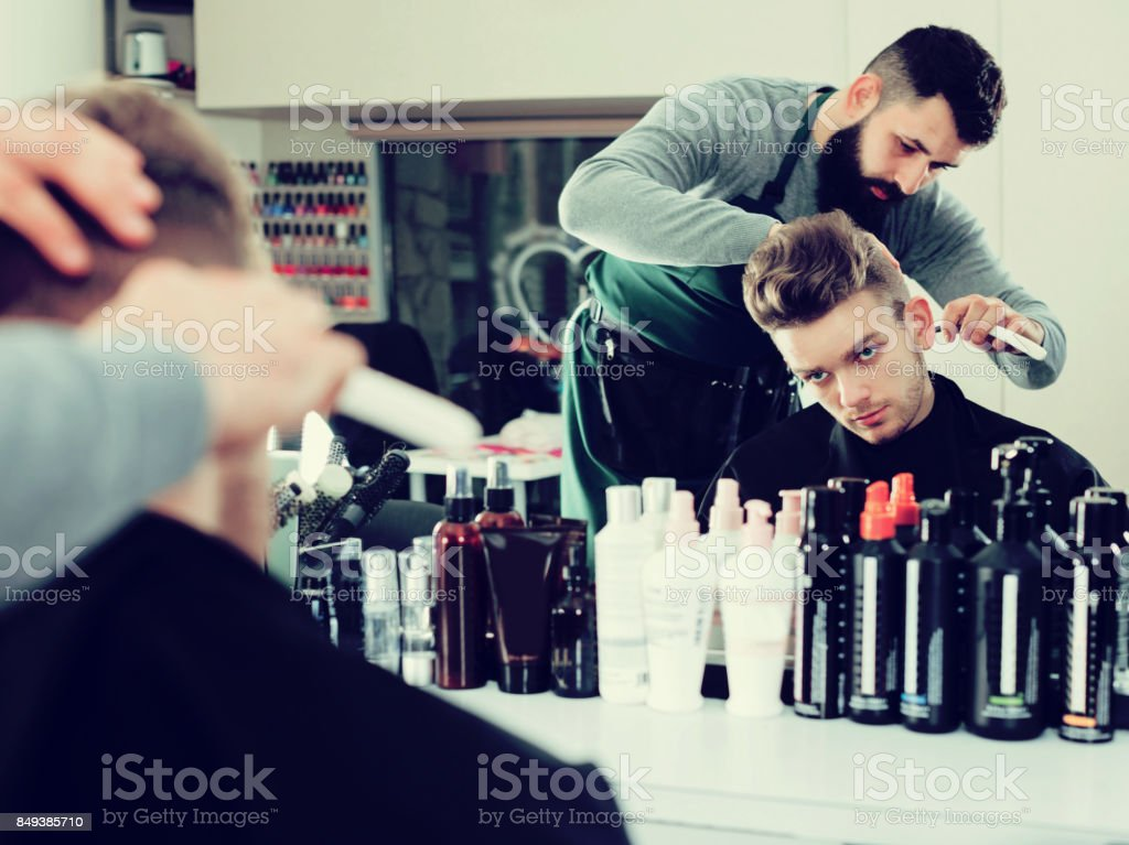 Client looking displeased about new haircut stock photo