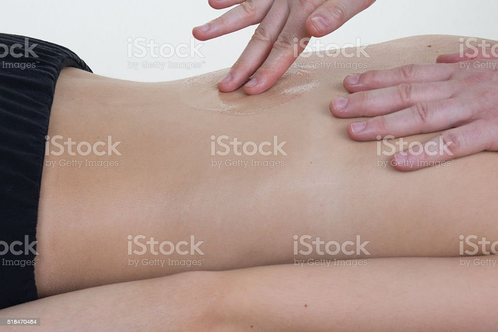 Client relaxing in massage at the spa center stock photo