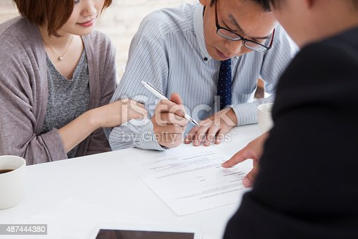 istock Client signing a real estate contract in real estate agency 487444380