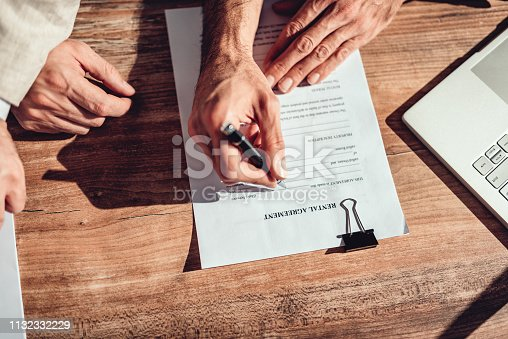 1072035844istockphoto Client signing rental agreement 1132332229