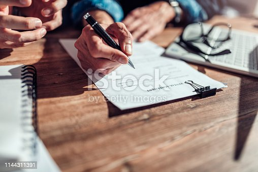 1072035844istockphoto Client signing rental agreement 1144311391