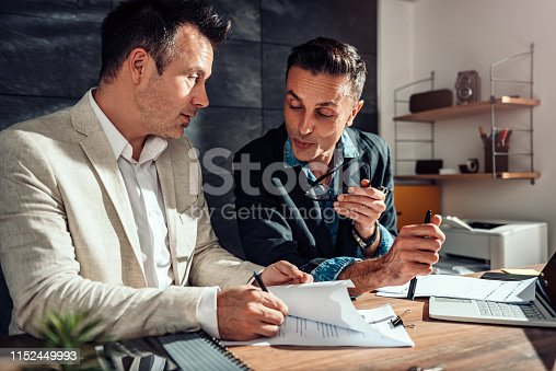 1072035844istockphoto Client singing contract 1152449993