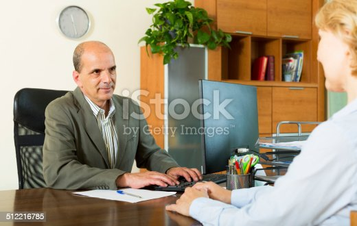 584597964 istock photo Client talking with notary 512216785