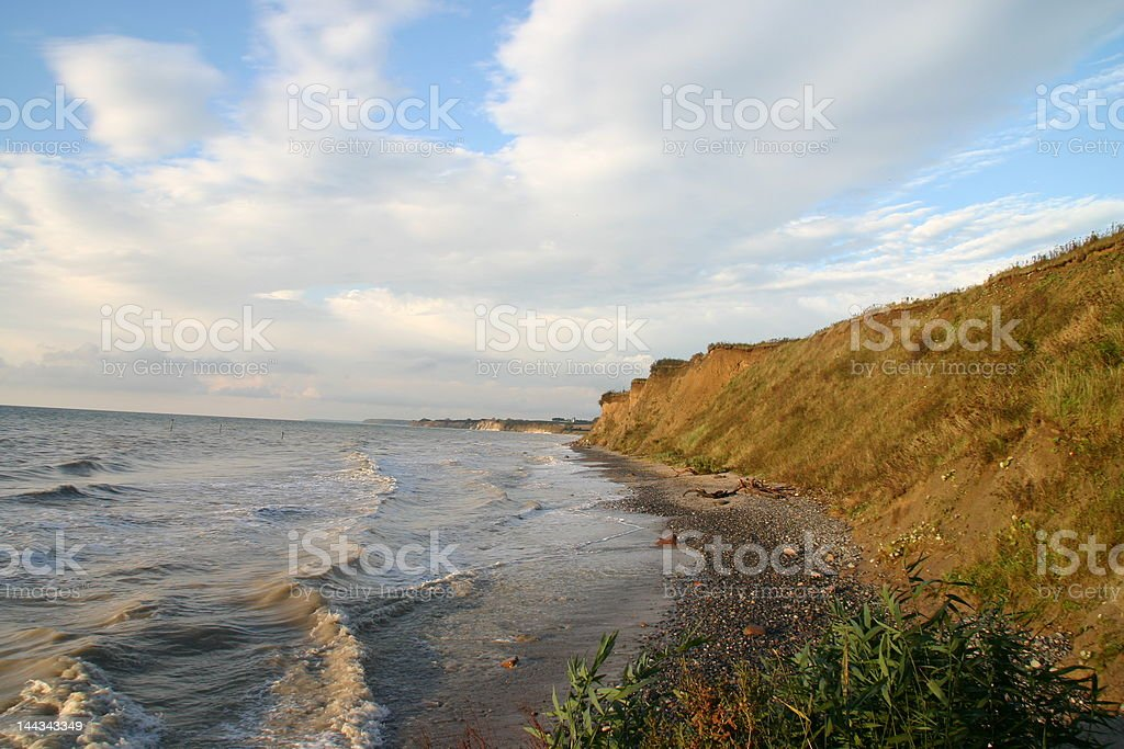 Cliff along the beach royalty-free stock photo